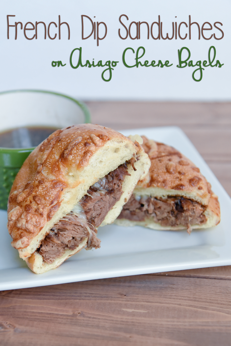 French Dip sandwiches with a twist. Traditional beef with aus jus on an asiago cheese bagel for added flavor! Easy and delicious in the slow cooker. by Penney Lane